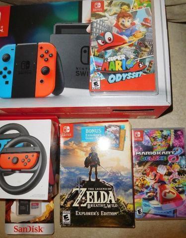 Nintendo Switch + Zelda BOTW+Mario Odyssey+Mario Kart 8 (Switch Neon)