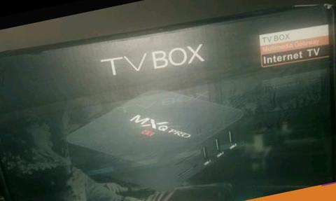 Vendo tv box nova na caixa com teclado de mxq