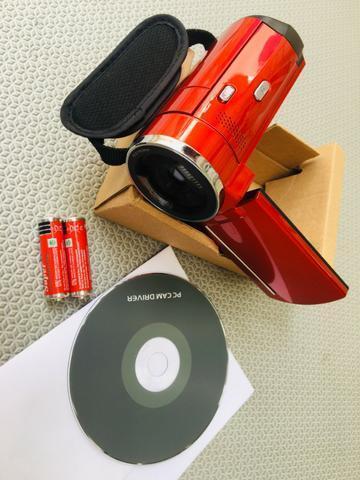Filmadora e máquina de fotos Nova, completa na caixa com cabo, manual e Dvd